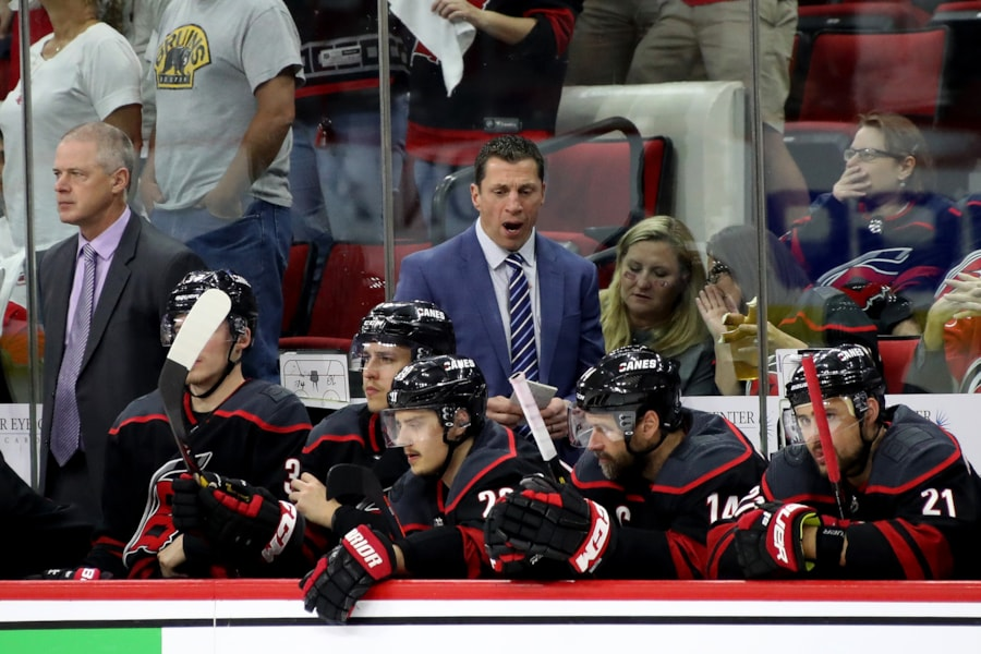 RALEIGH, NORTH CAROLINA - MAY 16: Head coach Rod Brind'Amour talks with his team on the bench against the Boston Bruins during the third period in Game Four of the Eastern Conference Finals during the 2019 NHL Stanley Cup Playoffs at PNC Arena on May 16, 2019 in Raleigh, North Carolina. (Photo by Bruce Bennett/Getty Images)