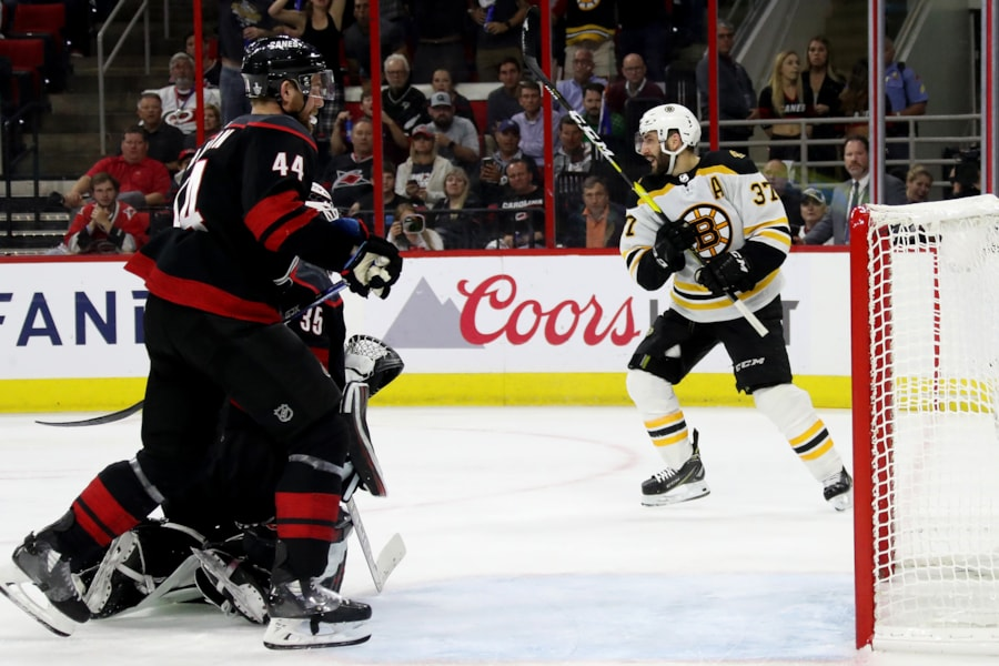 RALEIGH, NORTH CAROLINA - MAY 16: Patrice Bergeron #37 of the Boston Bruins celebrates after scoring a goal on Curtis McElhinney #35 of the Carolina Hurricanes during the third period in Game Four of the Eastern Conference Finals during the 2019 NHL Stanley Cup Playoffs at PNC Arena on May 16, 2019 in Raleigh, North Carolina. (Photo by Bruce Bennett/Getty Images)