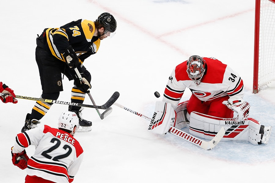 May 12, 2019; Boston, MA: Boston Bruins left wing Jake DeBrusk shoots on Carolina Hurricanes goaltender Petr Mrazek during the first period in Game 2 of the Eastern Conference Final of the 2019 Stanley Cup Playoffs at TD Garden. (Greg M. Cooper-USA TODAY Sports)