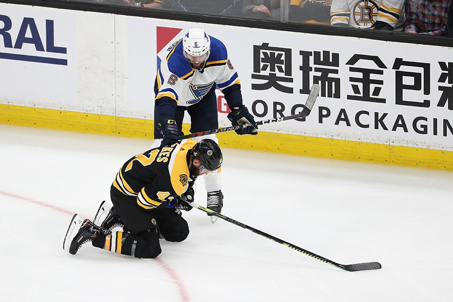 Joel Edmundson of the St. Louis Blues is called for high-sticking on David Backes of the Boston Bruins during the second period in Game 1 of the 2019 NHL Stanley Cup Final at TD Garden on May 27, 2019 in Boston, Massachusetts. (Photo by Patrick Smith/Getty Images)