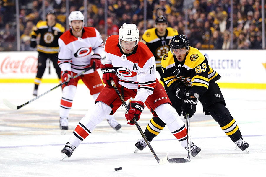 Brad Marchand of the Boston Bruins defends Jordan Staal of the Carolina Hurricanes during the first period at TD Garden on January 6, 2018 in Boston, Massachusetts. (Photo by Maddie Meyer/Getty Images)