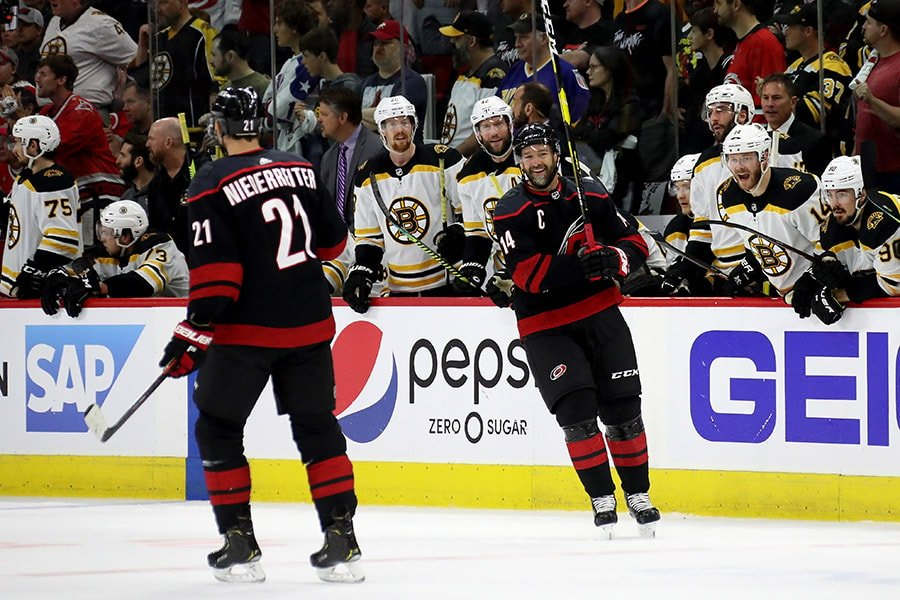 Justin Williams of the Carolina Hurricanes reacts after his second penalty against the Boston Bruins during the first period in Game 3 of the Eastern Conference Finals during the 2019 NHL Stanley Cup Playoffs at PNC Arena on May 14, 2019 in Raleigh, North Carolina. (Photo by Bruce Bennett/Getty Images)