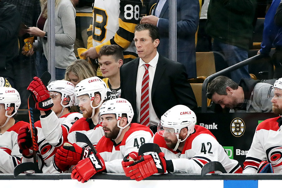 Head coach Rod Brind'Amour of the Carolina Hurricanes looks on in Game 1 of the Eastern Conference Final against the Boston Bruins during the 2019 NHL Stanley Cup Playoffs at TD Garden on May 09, 2019 in Boston, Massachusetts. (Photo by Bruce Bennett/Getty Images)
