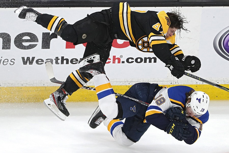 Torey Krug of the Boston Bruins checks Robert Thomas #18 of the St. Louis Blues during the third period in Game 1 of the 2019 NHL Stanley Cup Final at TD Garden on May 27, 2019 in Boston, Massachusetts. (Photo by Patrick Smith/Getty Images)