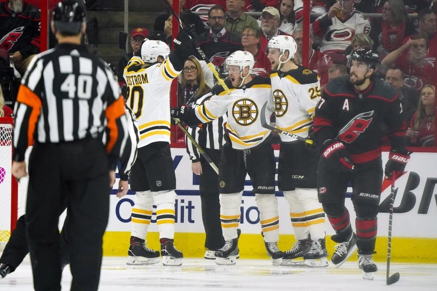 May 14, 2019; Raleigh, NC: Boston Bruins right wing Chris Wagner celebrates with defenseman Brandon Carlo and center Joakim Nordstrom after scoring a second period goal against the Carolina Hurricanes in Game 3 of the Eastern Conference Final of the 2019 Stanley Cup Playoffs at PNC Arena. (James Guillory-USA TODAY Sports)