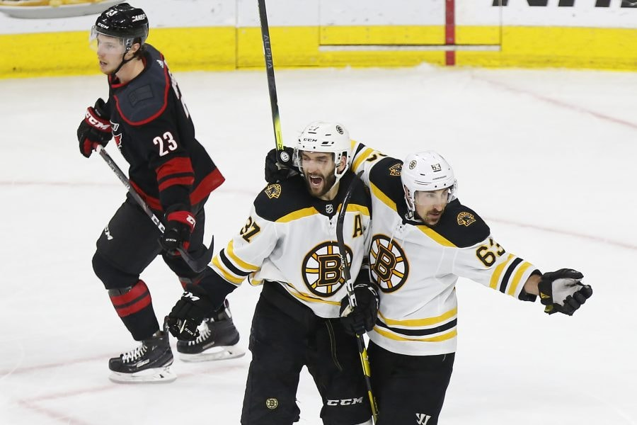 May 16, 2019; Raleigh, NC: Boston Bruins center Patrice Bergeron celebrates with Bruins left wing Brad Marchand after scoring a goal against the Carolina Hurricanes in the second period in Game 4 of the Eastern Conference Final of the 2019 Stanley Cup Playoffs at PNC Arena. (Geoff Burke-USA TODAY Sports)