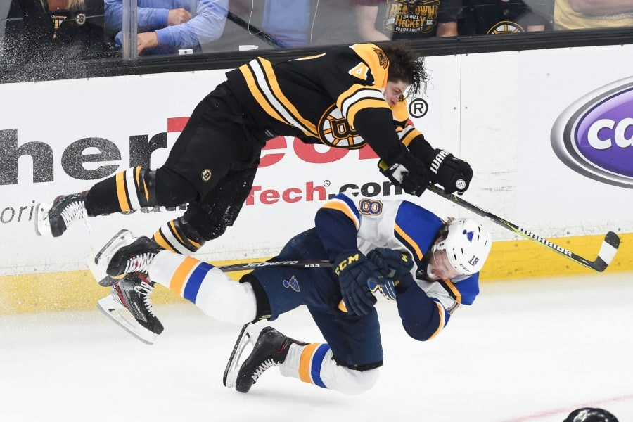 May 27, 2019; Boston, MA: St. Louis Blues center Robert Thomas takes a hit from Boston Bruins defenseman Torey Krug during the third period in Game 1 of the 2019 Stanley Cup Final at TD Garden. (Bob DeChiara-USA TODAY Sports)