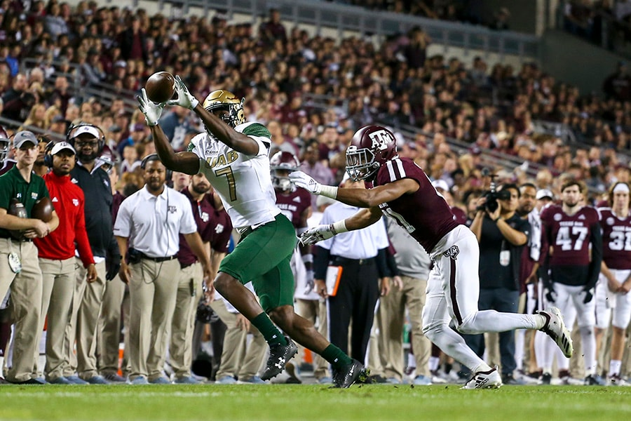 Nov 17, 2018; College Station, TX: UAB Blazers wide receiver Xavier Ubosi catches a pass during the first quarter while being defended by Texas A&M Aggies defensive back Larry Pryor at Kyle Field. (John Glaser-USA TODAY Sports)