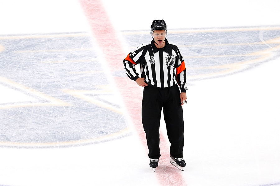 Referee Gord Dwyer announces a third period goal for Ryan O'Reilly (not pictured) of the St. Louis Blues after video replay against the Boston Bruins in Game 6 of the 2019 NHL Stanley Cup Final at Enterprise Center on June 09, 2019 in St Louis, Missouri. (Photo by Dilip Vishwanat/Getty Images)