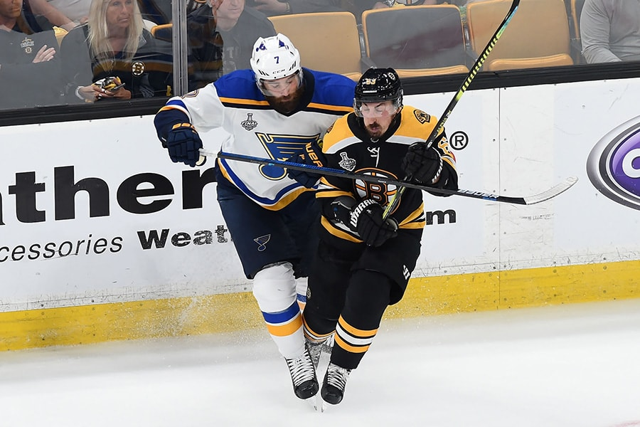 Jun 6, 2019; Boston, MA: Boston Bruins left wing Brad Marchand and St. Louis Blues left wing Pat Maroon collide during the second period in game five of the 2019 Stanley Cup Final at TD Garden. (Bob DeChiara-USA TODAY Sports)