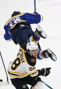 Brayden Schenn of the St. Louis Blues is checked by David Pastrnak of the Boston Bruins during Game 3 of the 2019 NHL Stanley Cup Final. (Photo by Jamie Squire/Getty Images)