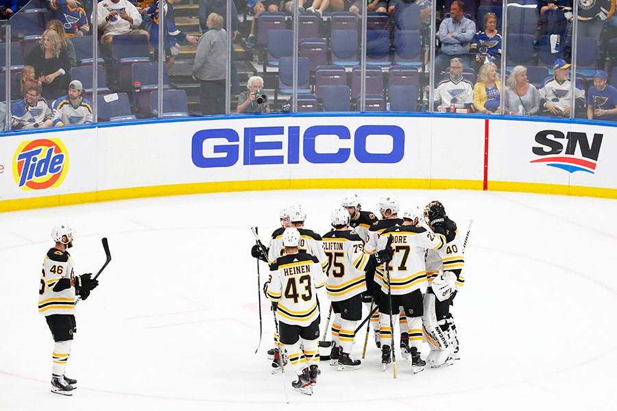 The Boston Bruins celebrate after defeating the St. Louis Blues 7-2 in Game 3 of the 2019 NHL Stanley Cup Final at Enterprise Center on June 01, 2019 in St Louis, Missouri. (Photo by Dilip Vishwanat/Getty Images)