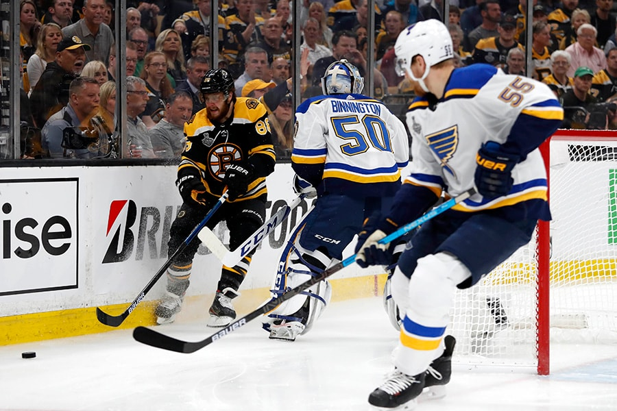 Jun 12, 2019; Boston, MA: Boston Bruins right wing David Pastrnak chases the puck against St. Louis Blues goaltender Jordan Binnington in the first period in Game 7 of the 2019 Stanley Cup Final at TD Garden. (Winslow Townson-USA TODAY Sports)