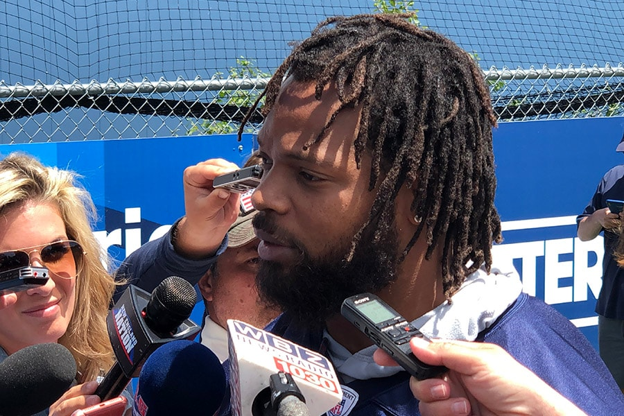 Michael Bennett speaks to reporters after practice for the New England Patriots at minicamp on June 4, 2019 in Foxborough, Mass. (Matt Dolloff/WBZ-FM)