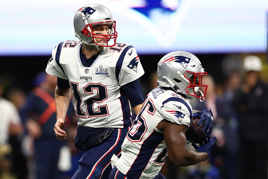 Tom Brady hands the ball off to Sony Michel of the New England Patriots in the first quarter against the Los Angeles Rams during Super Bowl LIII at Mercedes-Benz Stadium on February 03, 2019 in Atlanta, Georgia. (Photo by Maddie Meyer/Getty Images)