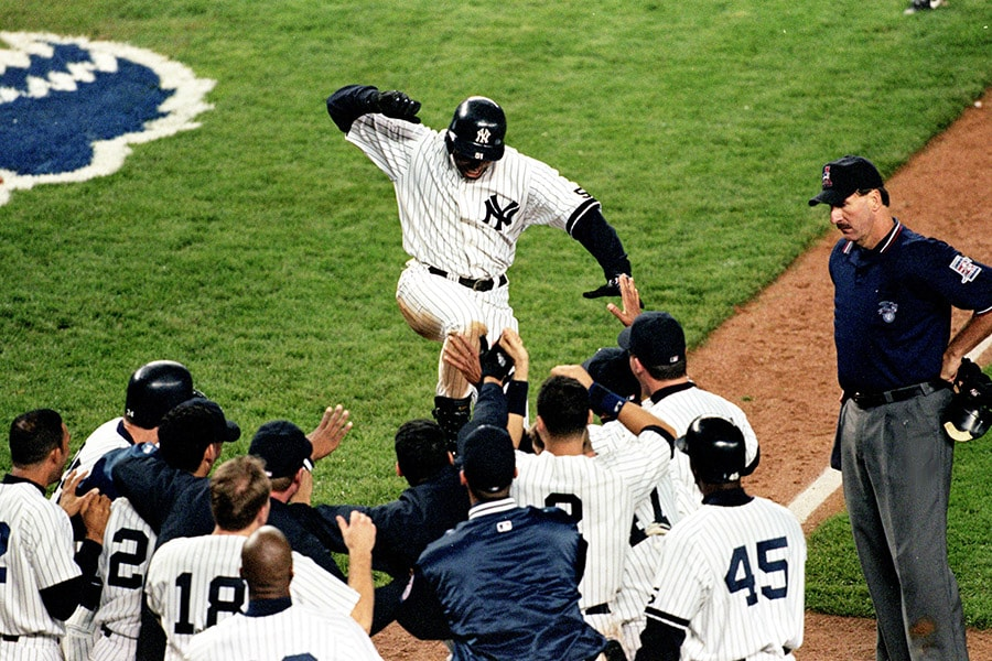 Center fielder Bernie Williams of the New York Yankees celebrates with teammates after hitting a game-winning home run against the Boston Red Sox during Game 1 of the American League Championship Series at Yankee Stadium in Bronx, New York on Oct. 13, 1999. The Yankees defeated the Red Sox 4-3. (Al Bello/Getty Images)