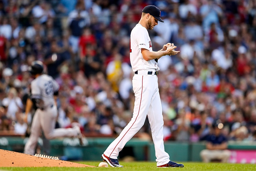 BOSTON, MA - JULY 28: Chris Sale of the Boston Red Sox looks on as Austin Romine of the New York Yankees rounds the bases after hitting a two-run home run in the third inning of a game at Fenway Park on July 28, 2019 in Boston, Massachusetts. (Photo by Adam Glanzman/Getty Images)