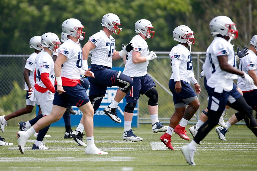 Jun 5, 2019; Foxborough, MA: New England Patriots tackle Dan Skipper (72) works out with other players during mandatory minicamp at the Gillette Stadium practice field. (Greg M. Cooper-USA TODAY Sports)