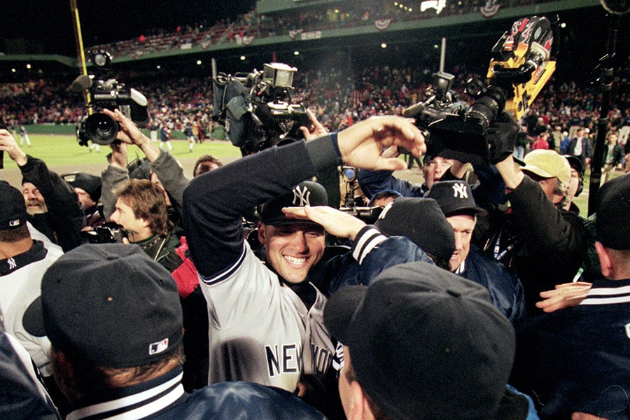The New York Yankees celebrate on the field after winning the American League Championship Series game five against the Boston Red Sox at Fenway Park in Boston, Massacusetts on Oct. 18, 1999. The Yankees defeated the Red Sox 6-1. (Jed Jacobsohn/Allsport)