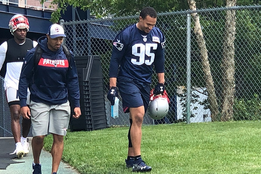 Defensive end Derek Rivers (95) heads to the practice field outside Gillette Stadium in Foxborough, Mass. for minicamp on June 5, 2019. (Matt Dolloff/WBZ-FM)