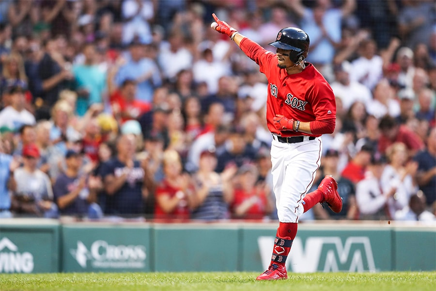 Mookie Betts of the Boston Red Sox reacts as he returns to the dugout after hitting a solo home run in the third inning of a game against the New York Yankees at Fenway Park on July 26, 2019 in Boston, Massachusetts. (Photo by Adam Glanzman/Getty Images)