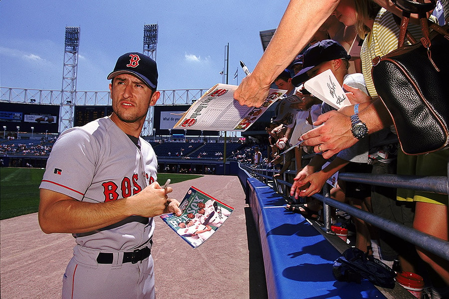 4 Jul 1999: Nomar Garciaparra of the Boston Red Sox signs fans programs before the game against the Chicago White Sox at Comisky Park in Chicago, Illinois. The Red Sox defeated the White Sox 5-2. (Getty Images)