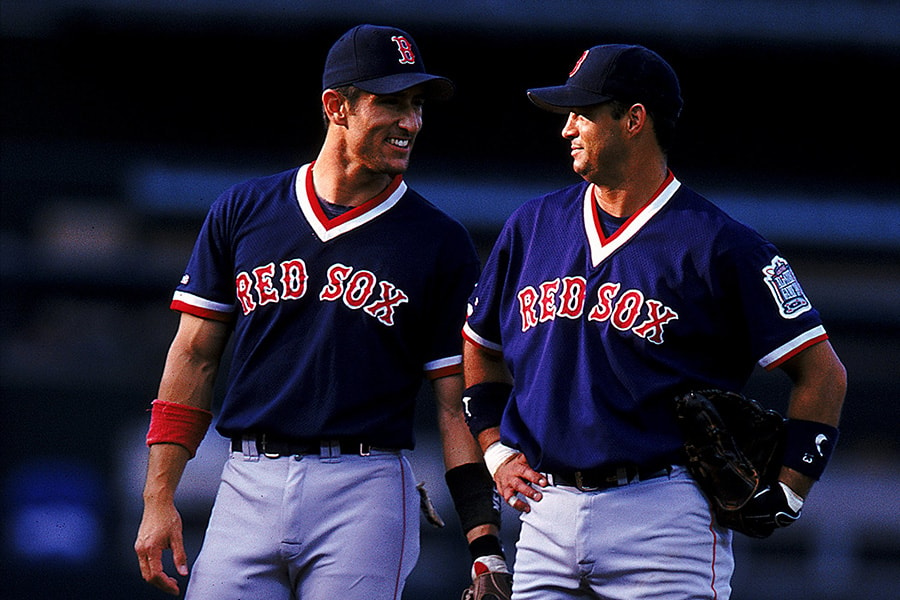 Nomar Garciaparra #5 of the Boston Red Sox talks to teammate John Valentin #13 during the game against the California Angels at Edison Field in Anaheim, California on Aug. 5, 1999. The Angels defeated the Red Sox 8-0. (Tom Hauck/Allsport)