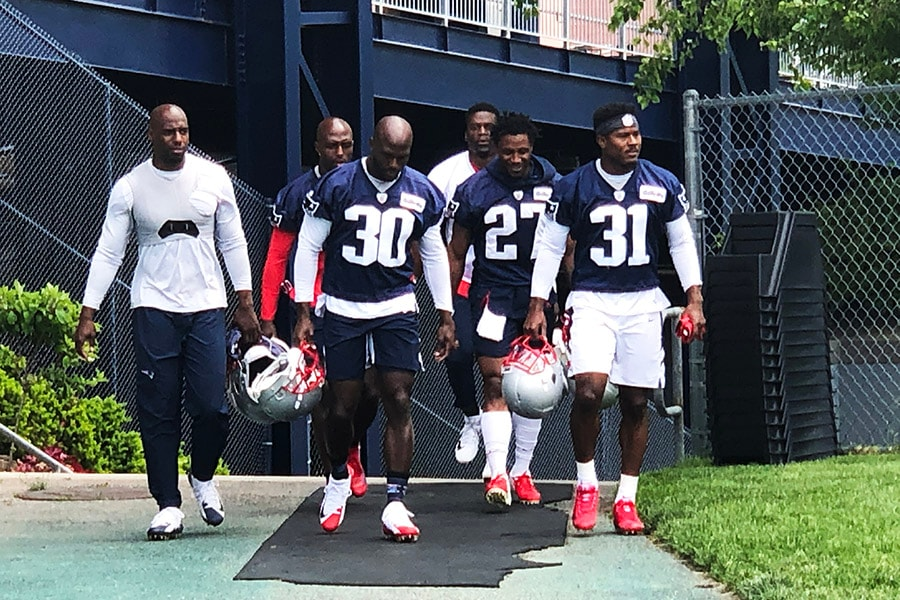Patriots defensive backs (L-R) Duron Harmon, Devin McCourty, Jason McCourty, J.C. Jackson, and Jonathan Jones head to the practice field outside Gillette Stadium in Foxborough, Mass. for minicamp on June 5, 2019. (Matt Dolloff/WBZ-FM)