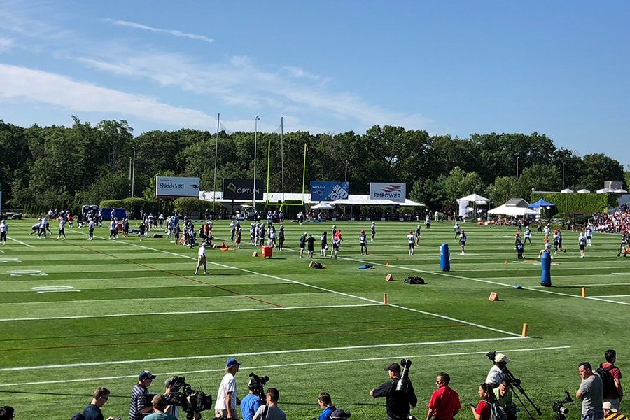 The New England Patriots take the field for the first day of training camp on July 25, 2019. (Matt Dolloff/WBZ-FM)
