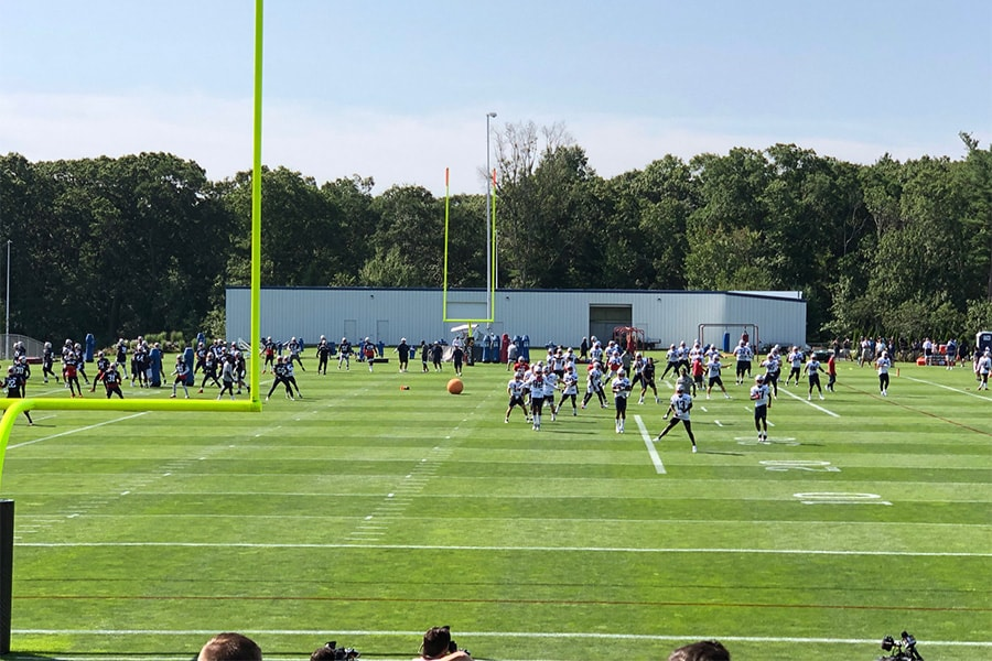 The New England Patriots hold a stretching period during training camp on July 26, 2019 in Foxborough, Mass. (Matt Dolloff/WBZ-FM)