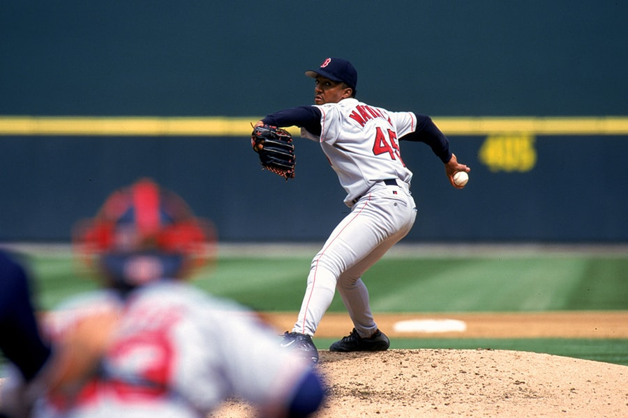 Pedro Martinez of the Boston Red Sox winds back to pitch the ball during a game against the Seattle Mariners at the Safeco Field in Seattle, Washington on Sept. 4, 1999. Martinez struck out 15 in 8 innings as the Red Sox defeated the Mariners 4-0. (Otto Greule Jr./Allsport)