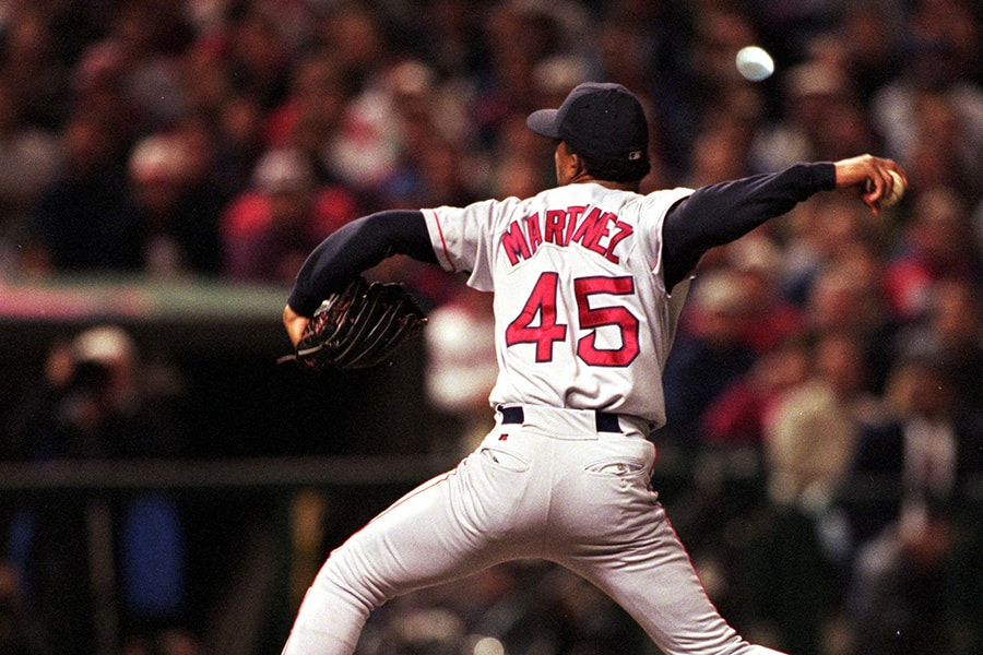 Pedro Martinez of the Boston Red Sox winds back to pitch the ball during Game 5 against the Cleveland Indians at Jacobs Field in Cleveland, Ohio on Oct. 11, 1999. The Red Sox defeated the Indians 12-8. (Jonathan Daniel/Allsport)