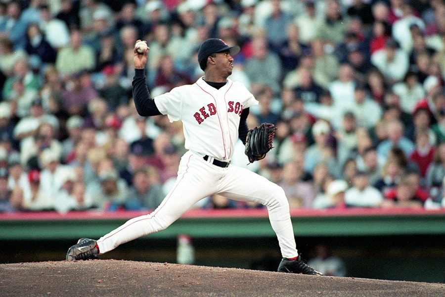 Pedro Martinez of the Boston Red Sox winds up for the pitch during the ALCS game three against the New York Yankees at Fenway Park in Boston, Massachusetts. The Red Sox defeated the Yankees 13-1. (Jonathan Daniel/Allsport)