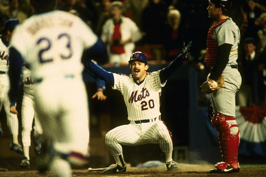 Oc. 27, 1986: Howard Johnson of the New York Mets celebrates after scoring at home plate during the Mets 8-5 win over the Boston Red Sox in Game 7 of the World Series at Shea Stadium in Flushing, New York. The Mets won the series 4-3. (T.G. Higgins/Stringer/Getty Images)