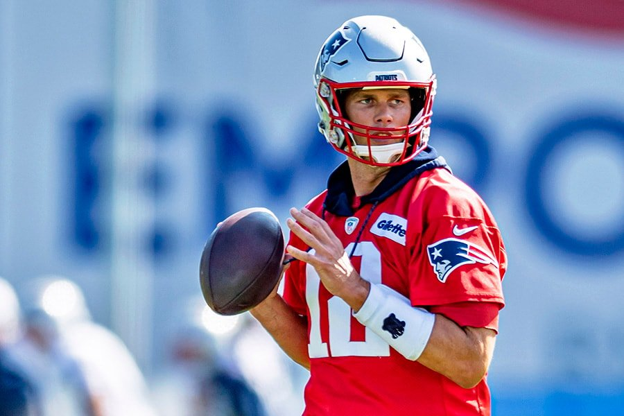 Jul 25, 2019; Foxborough, MA: New England Patriots quarterback Tom Brady warms up during the 2019 season opening Training Camp at Gillette Stadium. (Ed Wolfstein-USA TODAY Sports)