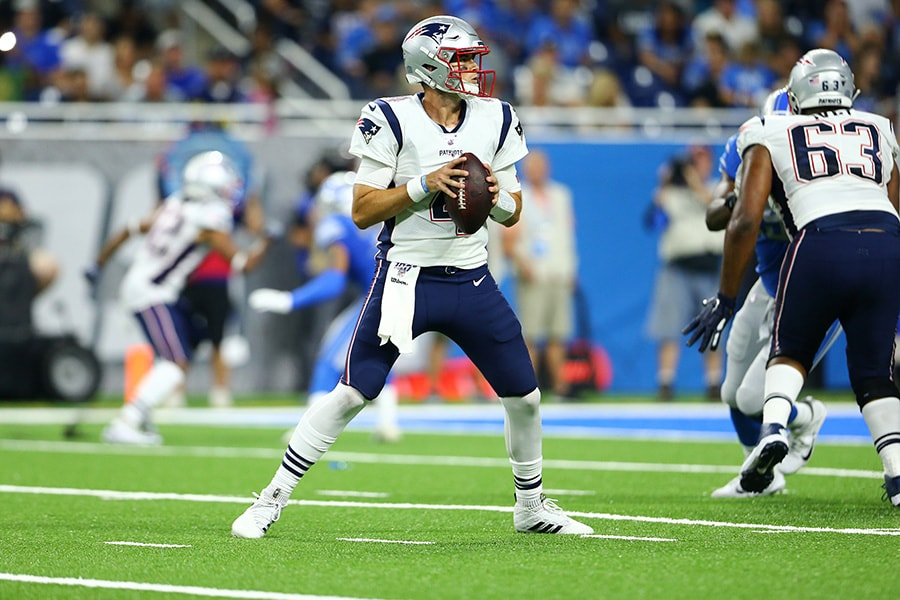 Jarrett Stidham of the New England Patriots drops back to pass during the second quarter of the game against the Detroit Lions during the preseason game at Ford Field on August 8, 2019 in Detroit, Michigan. (Photo by Rey Del Rio/Getty Images)