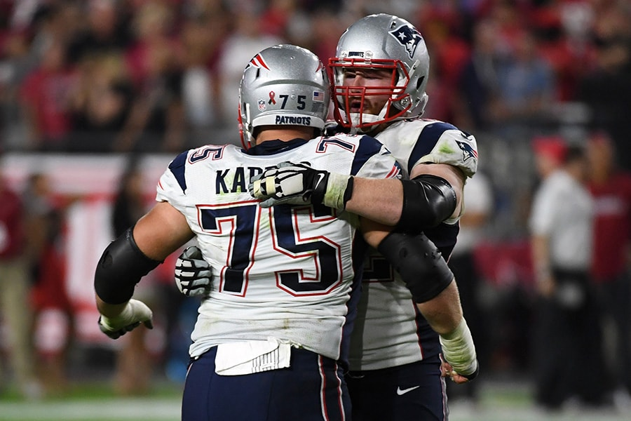 Offensive guard Ted Karras of the New England Patriots hugs offensive guard Joe Thuney after defeating the Arizona Cardinals at University of Phoenix Stadium on September 11, 2016 in Glendale, Arizona. The New England Patriots won 23-21. (Photo by Ethan Miller/Getty Images)
