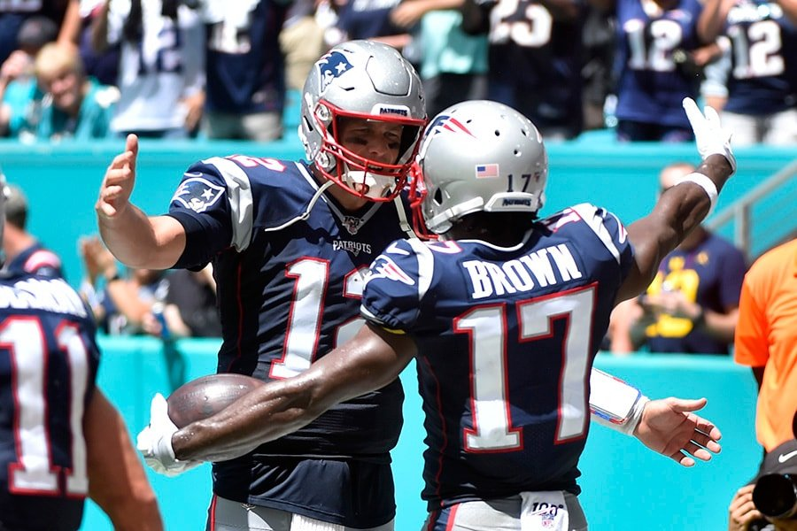 MIAMI, FL - SEPTEMBER 15: Antonio Brown of the New England Patriots celebrates with Tom Brady after catching a touchdown in the second quarter of the game against the Miami Dolphins at Hard Rock Stadium on September 15, 2019 in Miami, Florida. (Photo by Eric Espada/Getty Images)