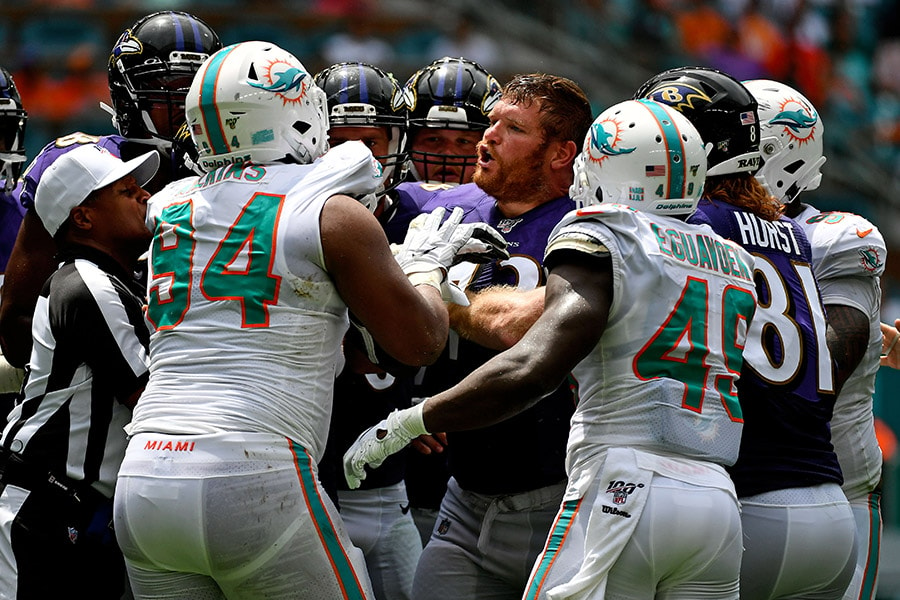 Sep 8, 2019; Miami Gardens, FL, USA; Miami Dolphins defensive tackle Christian Wilkins (94) and Baltimore Ravens offensive guard Marshal Yanda (73) tussle during the first half at Hard Rock Stadium. (Jasen Vinlove-USA TODAY Sports)