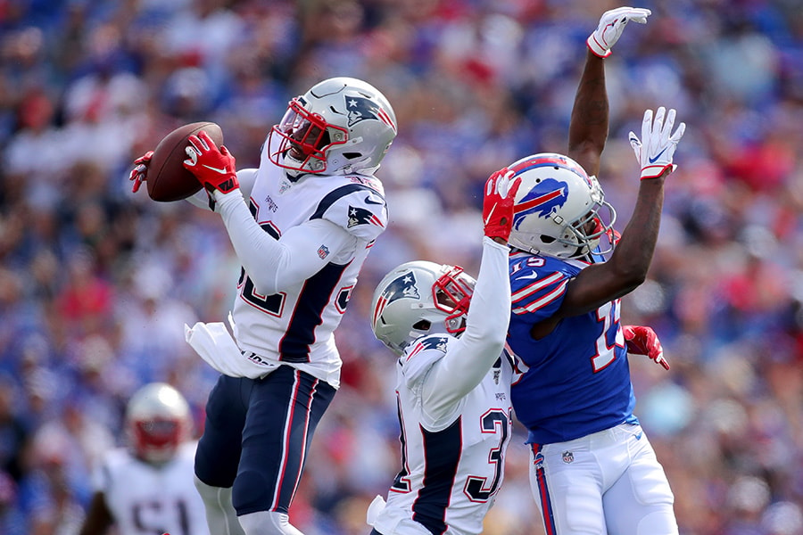 Devin McCourty of the New England Patriots intercepts a pass intended for John Brown of the Buffalo Bills during the first quarter in the game at New Era Field on September 29, 2019 in Buffalo, New York. (Photo by Brett Carlsen/Getty Images)