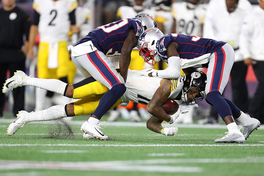Donte Moncrief of the Pittsburgh Steelers is tackled by the New England Patriots during the second half at Gillette Stadium on September 08, 2019 in Foxborough, Massachusetts. (Photo by Maddie Meyer/Getty Images)