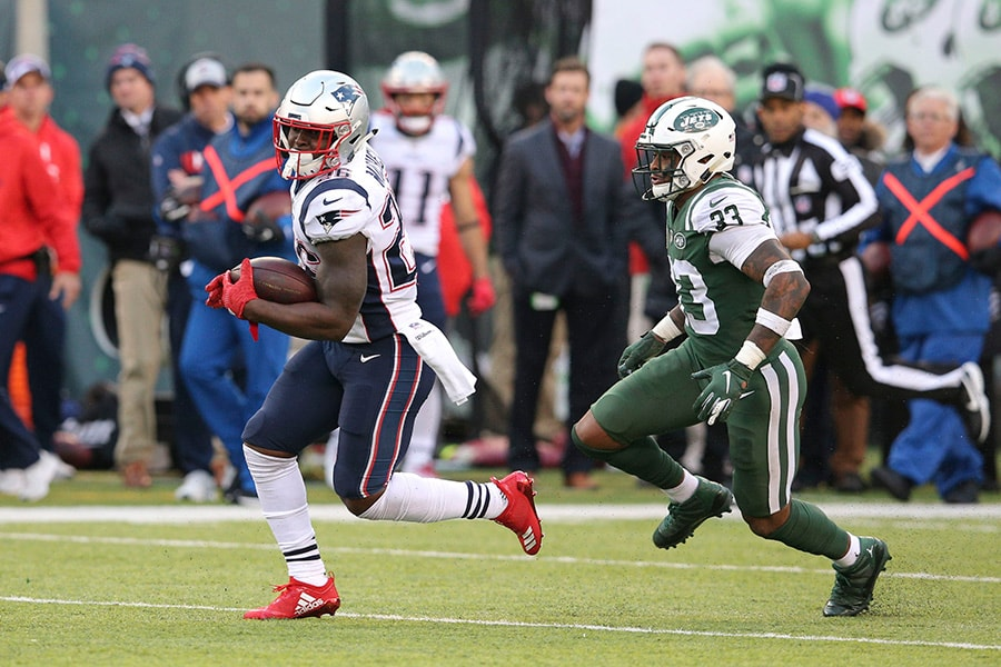 Nov 25, 2018; East Rutherford, NJ: New England Patriots running back Sony Michel runs the ball against New York Jets safety Jamal Adams during the fourth quarter at MetLife Stadium. (Brad Penner-USA TODAY Sports)