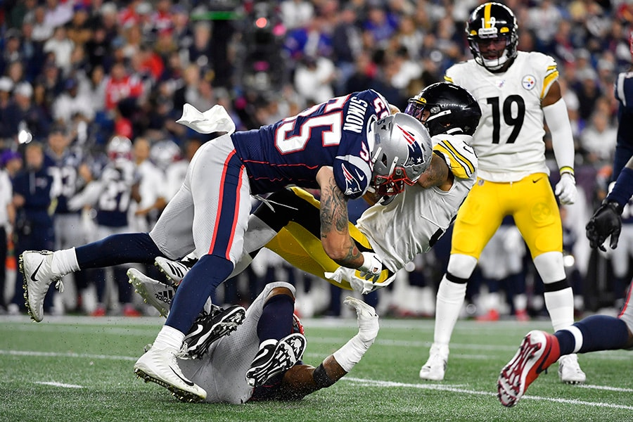 James Conner of the Pittsburgh Steelers is tackled by John Simon of the New England Patriots during the second half at Gillette Stadium on September 08, 2019 in Foxborough, Massachusetts. (Photo by Kathryn Riley/Getty Images)