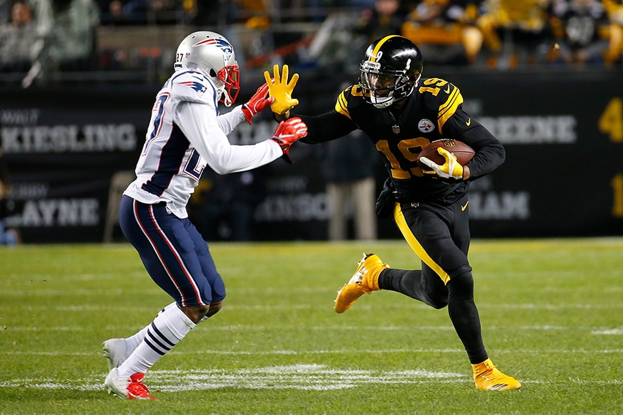 PITTSBURGH, PA - DECEMBER 16: JuJu Smith-Schuster of the Pittsburgh Steelers runs up field after a catch as J.C. Jackson of the New England Patriots attempts a tackle in the first half during the game at Heinz Field on December 16, 2018 in Pittsburgh, Pennsylvania. (Photo by Justin K. Aller/Getty Images)