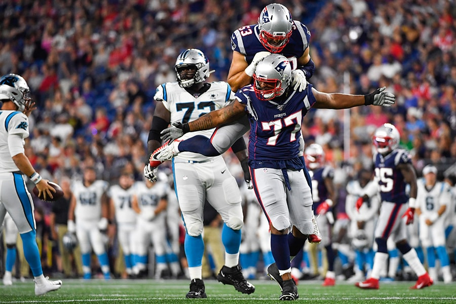 Michael Bennett celebrates with teammate Kyle Van Noy of the New England Patriots after completing a sack in the third quarter during a preseason game at Gillette Stadium on August 22, 2019 in Foxborough, Massachusetts. (Photo by Kathryn Riley/Getty Images)