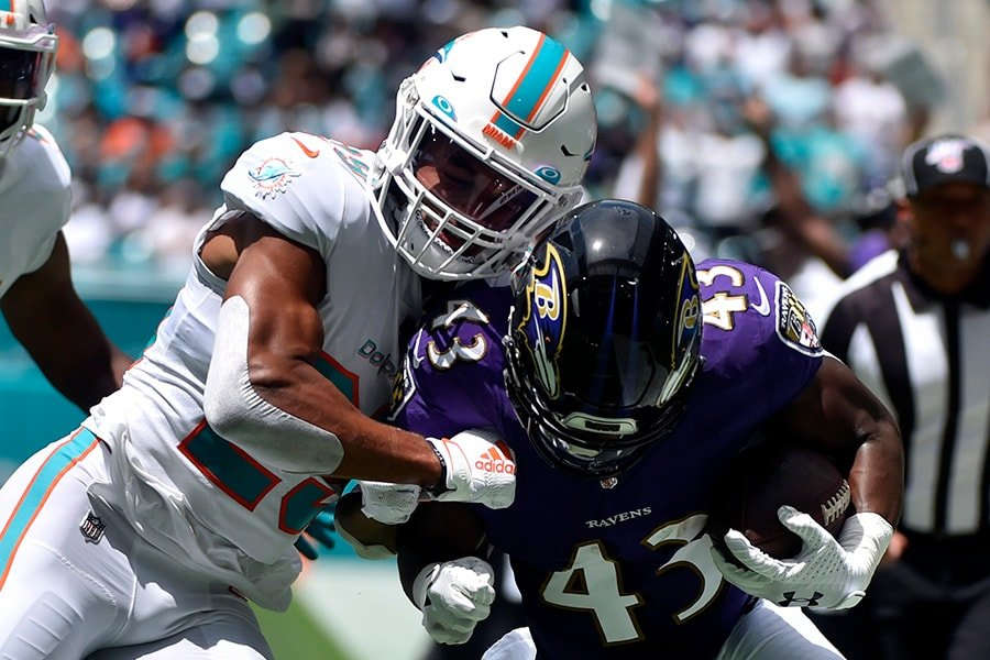 Minkah Fitzpatrick #29 of the Miami Dolphins knocks Justice Hill #43 of the Baltimore Ravens out of bounds during the first quarter of the game at Hard Rock Stadium on September 8, 2019 in Miami, Florida. (Photo by Eric Espada/Getty Images)