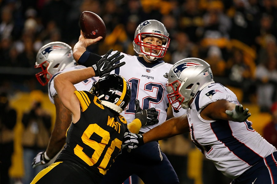 PITTSBURGH, PA - DECEMBER 16: Tom Brady of the New England Patriots drops back to pass under pressure from T.J. Watt of the Pittsburgh Steelers in the first half during the game at Heinz Field on December 16, 2018 in Pittsburgh, Pennsylvania. (Photo by Justin K. Aller/Getty Images)