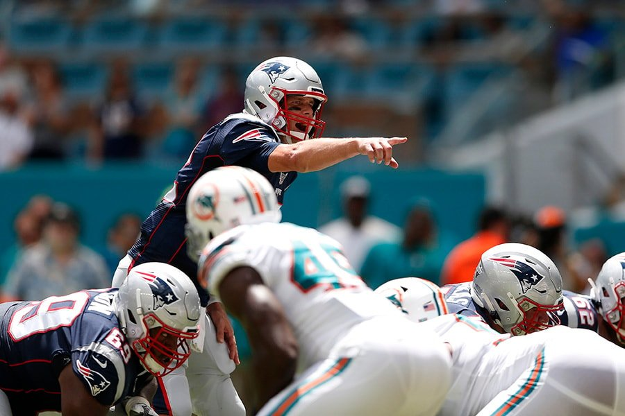 Tom Brady of the New England Patriots calls a play prior to the snap against the Miami Dolphins during the first quarter in the game at Hard Rock Stadium on September 15, 2019 in Miami, Florida. (Photo by Michael Reaves/Getty Images)