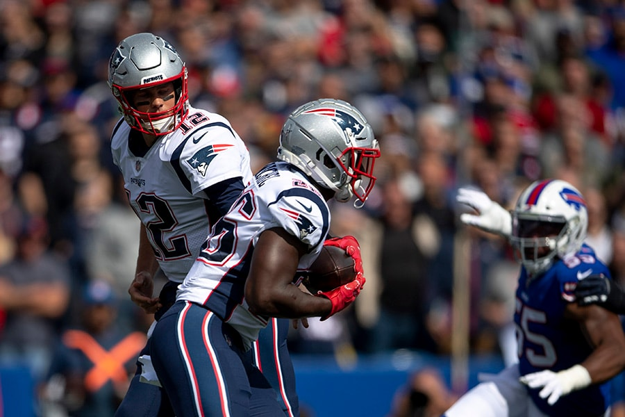 Sep 29, 2019; Orchard Park, NY: New England Patriots quarterback Tom Brady hands the ball off to running back Sony Michel during the first quarter against the Buffalo Bills at New Era Field. (Douglas DeFelice-USA TODAY Sports)