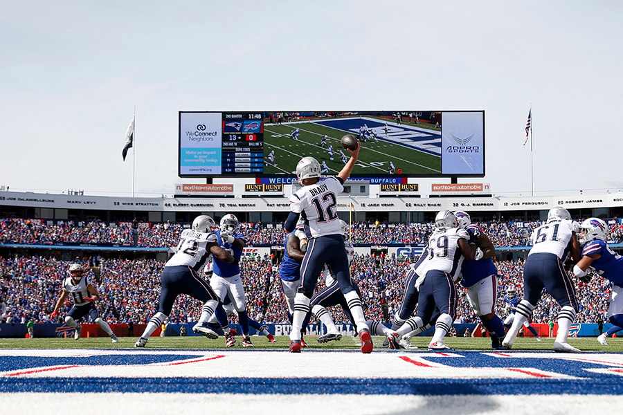 ORCHARD PARK, NY - SEPTEMBER 29: Tom Brady of the New England Patriots throws a pass to Julian Edelman of the New England Patriots during the first half against the Buffalo Bills at New Era Field on September 29, 2019 in Orchard Park, New York. (Photo by Timothy T Ludwig/Getty Images)